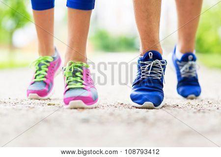 Couple running feet close-up