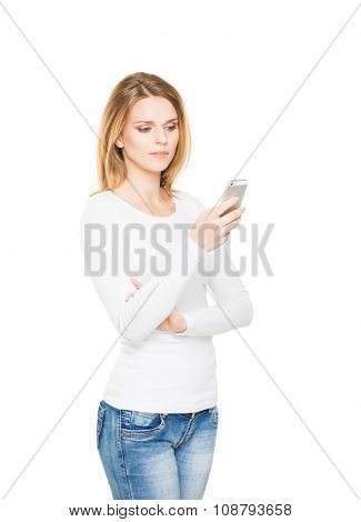 Young and attractive teenage girl with the mobile phone isolated on white
