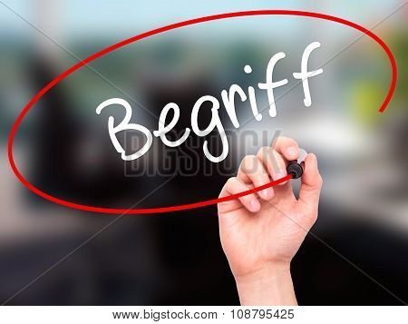Man Hand writing Begriff (Terms in German) with black marker on visual screen.Background office