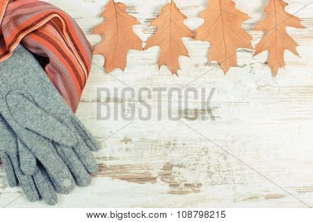 Vintage Photo, Womanly Woolen Clothes And Autumnal Leaves With Copy Space For Text, Old Rustic Woode