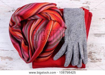 Womanly Clothes For Autumn Or Winter On Old Rustic Wooden Background