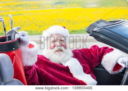 Santa Driving Convertible With Golf Clubs