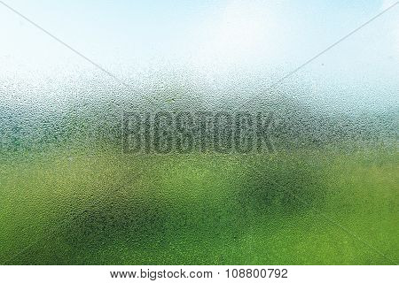 Droplets on glass in the morning with nature view