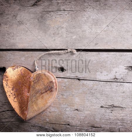 Decorative  Heart On Aged Wooden   Background.
