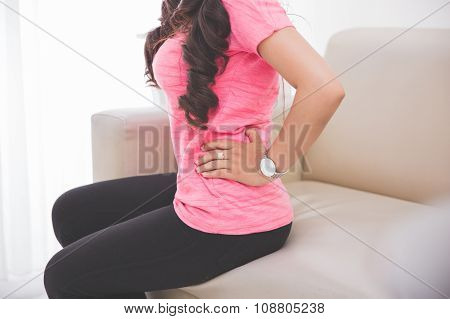 Women Feeling Unwell On Her Stomach