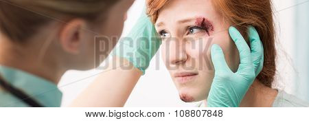 Woman With Cut Eyebrow