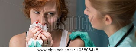 Woman With Bleeding Nose