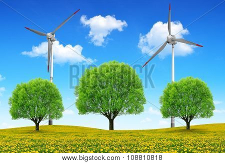 Trees with wind turbines on meadow. Spring landscape.