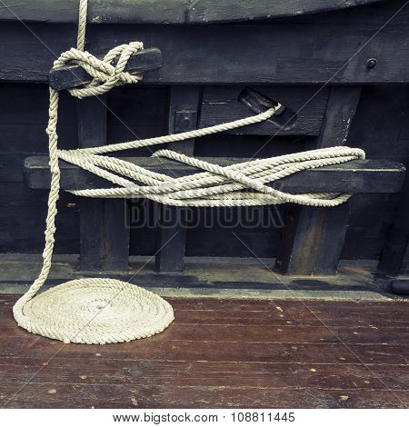 Coiled Maritime Rope On Wooden Deck