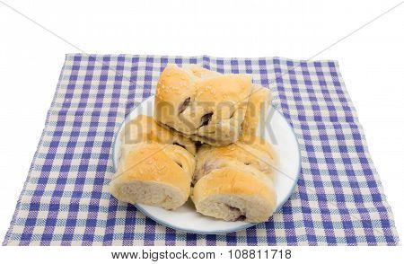taro buns on white dish