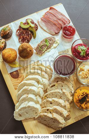 Various Tapas On Chopping Board