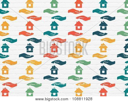 Insurance concept: House And Palm icons on wall background