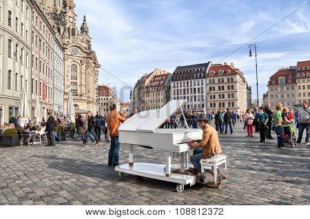 Man Plays On A Grand Piano On Neumarkt Square In Dresden