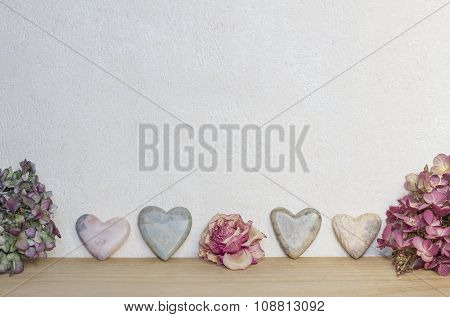 Light Marbled Background With  Hearts And Dried Flowers
