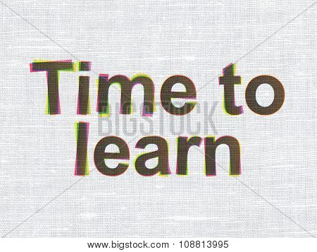 Learning concept: Time to Learn on fabric texture background