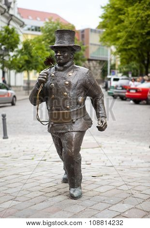 TALLINN ESTONIA- JUNE 16: Monument to the chimney sweep in the Old city on June 16 2012 in Tallinn E