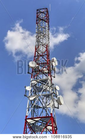 Communication antenna tower on blue sky