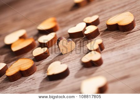 wooden hearts on brown board