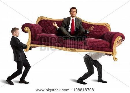 Boss doing yoga on sofa