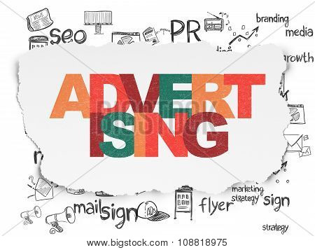 Marketing concept: Advertising on Torn Paper background