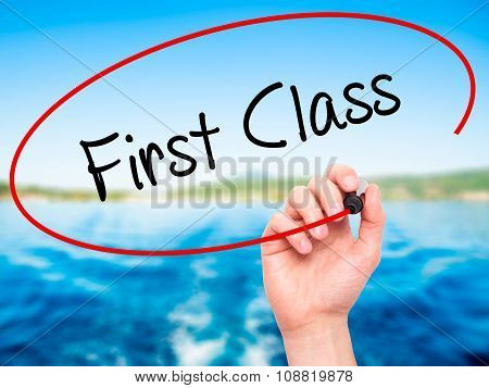 Man Hand writing First Class with black marker on visual screen.