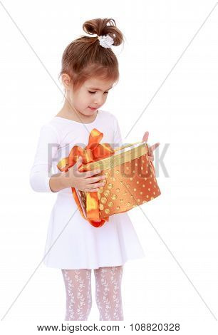 cute little girl with a gift