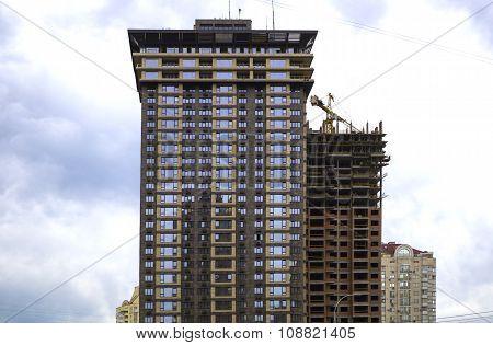 High Modern House Skyscraper Building And Blue Sky