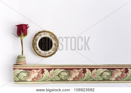 Cup of coffee with red rose and wallpaper