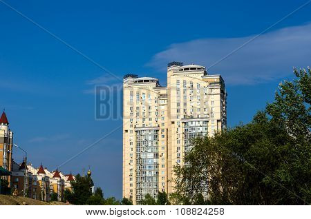 Kiev, Ukraine - July 20, 2015: Group Of Modern Multi-storey Yellow And White Big Houses On Backgroun
