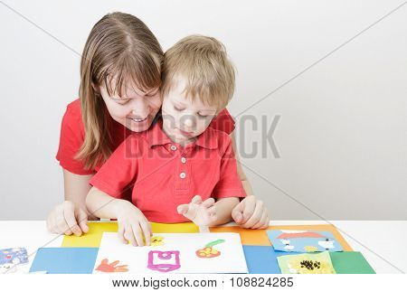 mother and son molding from play daugh