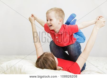 mother and son playing at home
