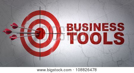 Finance concept: target and Business Tools on wall background