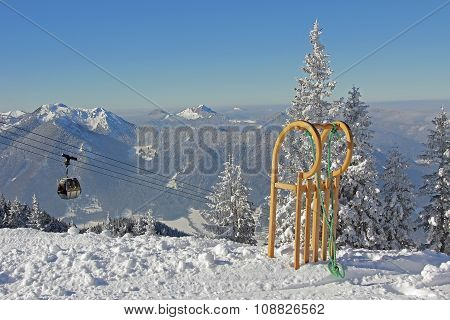 Mountainous Landscape With Ropeway And Long Horn Sledge