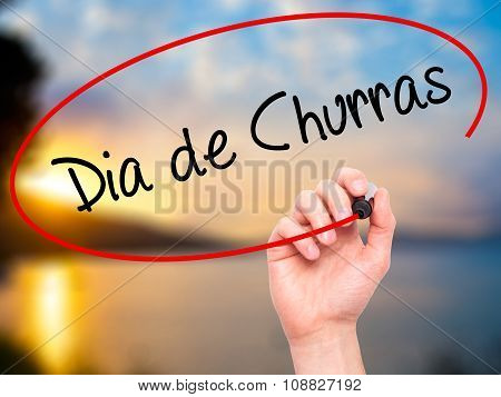 Man Hand writing Dia de Churras (Barbecue Day In Portuguese) with black marker on visual screen.