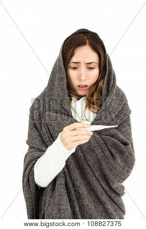 Woman Checking Her Fever Looking Worried