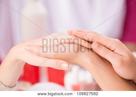 Professional manicurist making manicure
