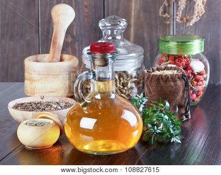 Therapeutic Herbal Tincture, Alternative Medicine, Love Potions, Dried Herbs On A Wooden Table.
