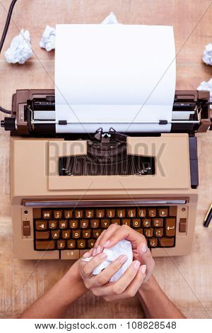 Above view of old typewriter on wooden desk