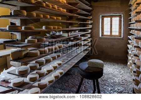 Alpine Hut That Produces  Homemade Cheeses.