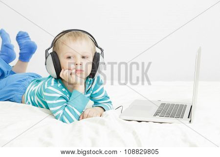 little boy listening to music in headphones