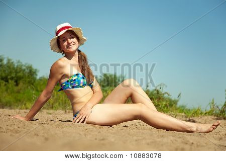 Girl Enjoying The Sandbeach