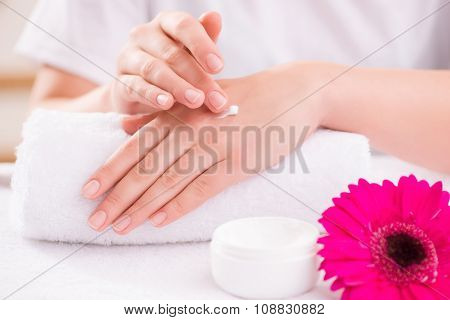 Pleasant woman making hand massage