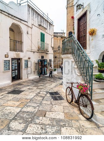 Typical White Street With Bicycle  In Ostuni, Italy