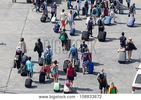 Passengers Disembark From The Ship At The Port Of Paros In Greece