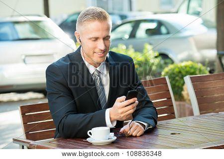 Businessman Listening Music
