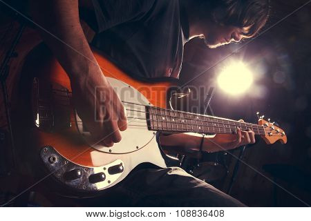 guy playing bass