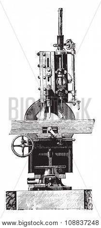 Slotting machine, Front view, vintage engraved illustration. Industrial encyclopedia E.-O. Lami - 1875.
