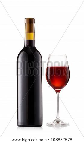 Dark bottle and glass with wine