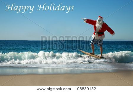 Surfing Santa. Santa Claus Surfs on his Surf Board while on a Beautiful Beach with a Blue Ocean. Focus on Santa/s Face. Santa Vacation. Surfing Santa. Santa goes Surfing.