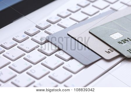 Bank card on computer keyboard
